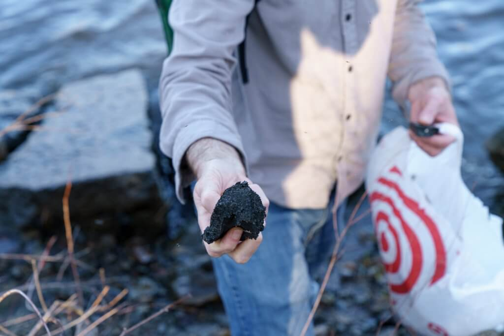 Black styrofoam polluting river.