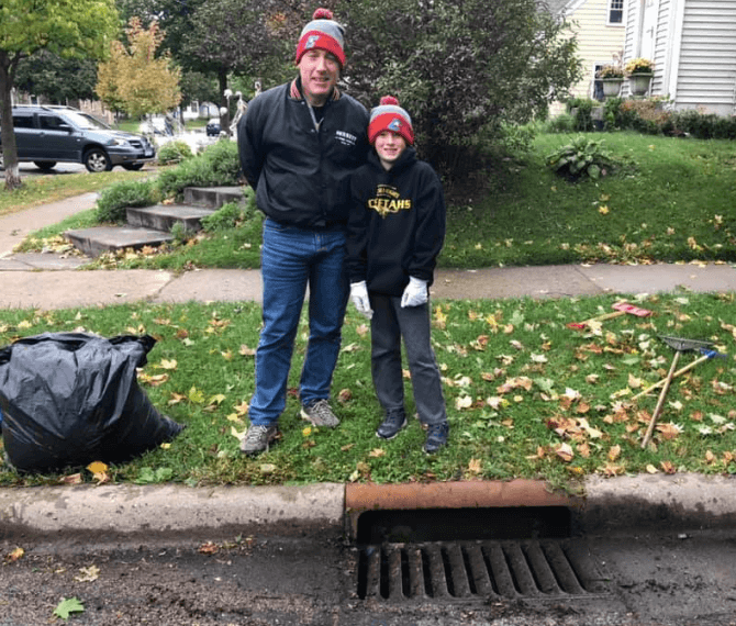 Drain adopters smiling near their cleaned storm drain.